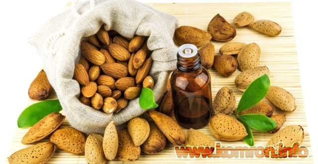 Almonds in the sack and almond oil on mat isolated on white background