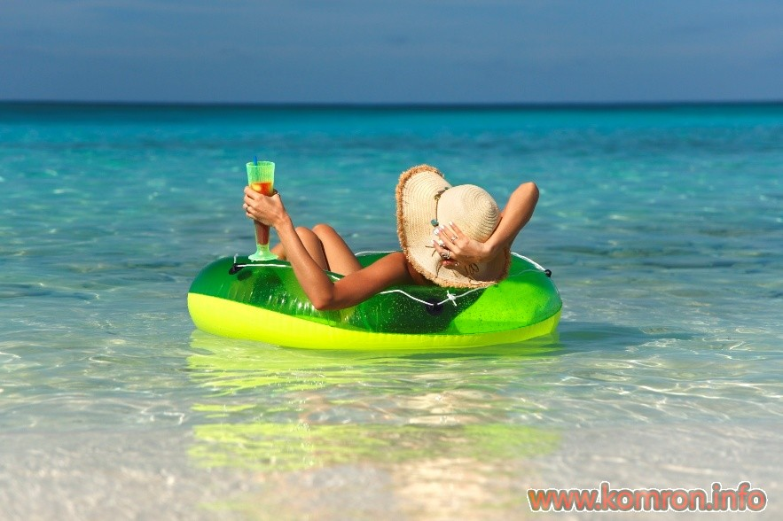 woman relaxing in an innertube at tropical paradise