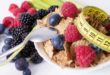 fruits with cereals and tape measure, diet concept
